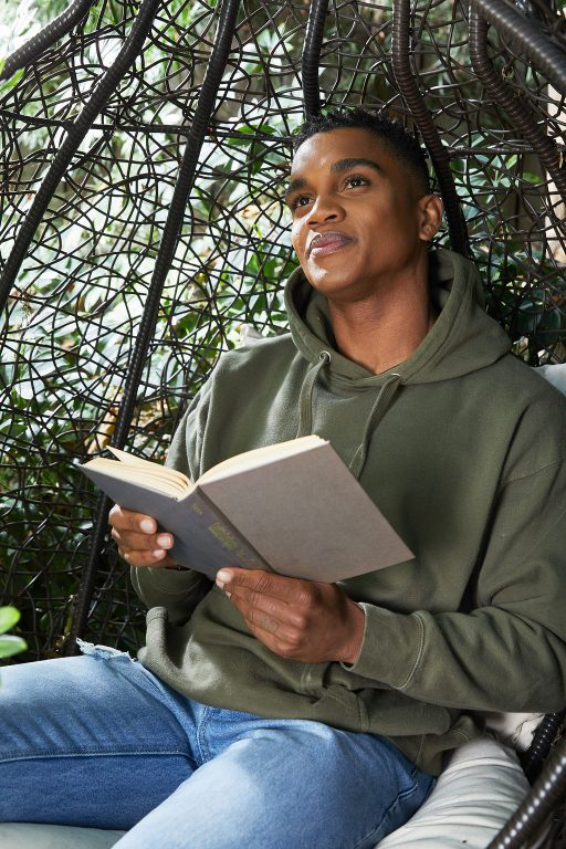 Man with book in outdoor bench