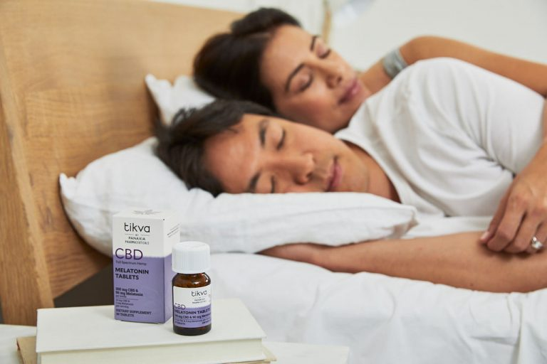 A couple sleeping well as a result of using Tikva CBD + Melatonin Product