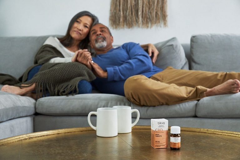 Couple sitting and cuddling with Tikva Shot 17 Oral Tablets