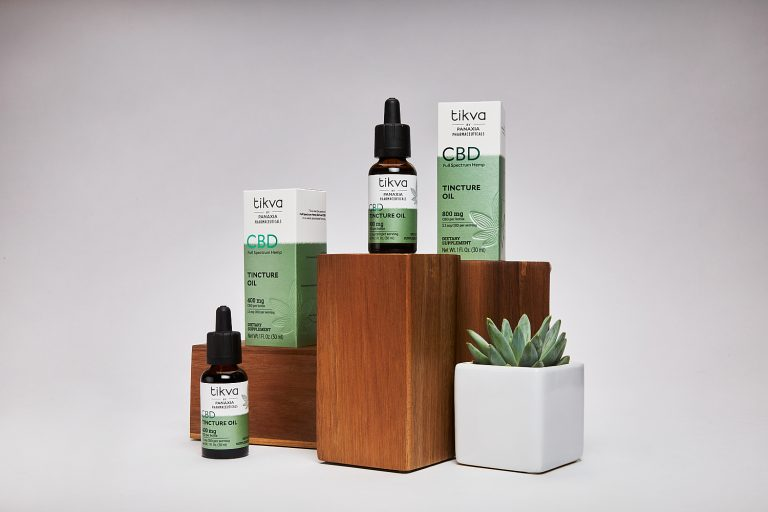Tikva CBD Tincture Oil on Wooden Boxes with Succulents